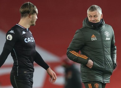 Jack Grealish chats to the United boss.
