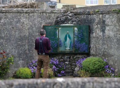 File image of author John Pascal Rodgers at a grotto on the grounds of the unmarked mass grave in Tuam, Co Galway.