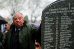Chairman of the Bethany Survivors group Derek Leinster looks at the memorial to 222 children from the Bethany Mother and Child Home, at Mount Jerome Cemetery, Harold's Cross, Dublin, as it is unveiled.