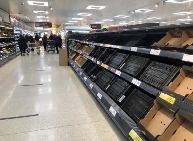 Depleted shelves in Sainsburys at the Forestside shopping centre in Belfast yesterday.