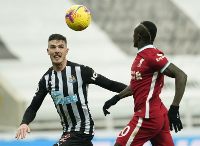 Newcastle United's Ciaran Clark battling for possession with Sadio Mane of Liverpool during Wednesday's goalless draw.