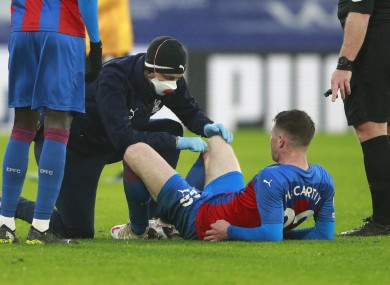 Crystal Palace's James McCarthy receives medical treatment.