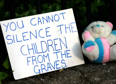 A sign and a teddy bear outside Leinster House in 2014 during a protest over the burial of babies at an institution in Tuam.
