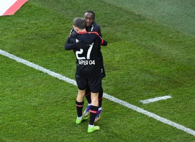 Moussa Diaby and Florian Wirtz celebrate.