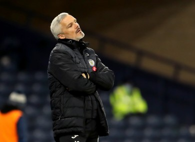 Jim Goodwin reacts during his side's defeat.
