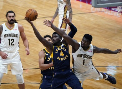 Indiana Pacers guard Victor Oladipo (4) and New Orleans Pelicans forward Zion Williamson (1) battle under the basket.