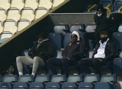 Crystal Palace's Eberechi Eze (left) watches the match from the stands.