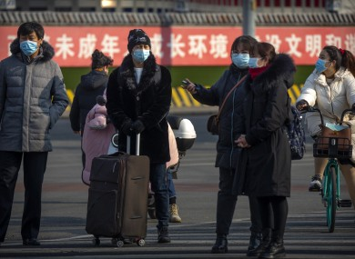People wearing face masks in Beijing today.
