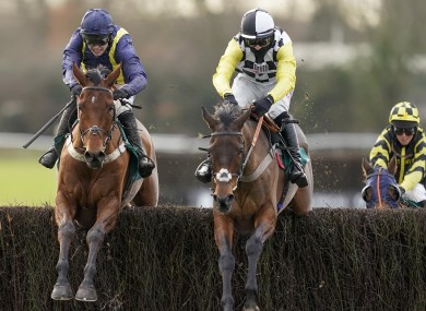 Next Destination ridden by Harry Cobden(black/white cap) clears the last ahead of Fiddlerontheroof.