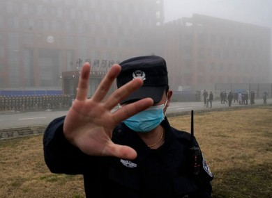 A security guard outside a lab in Wuhan that was visited by WHO officials last week