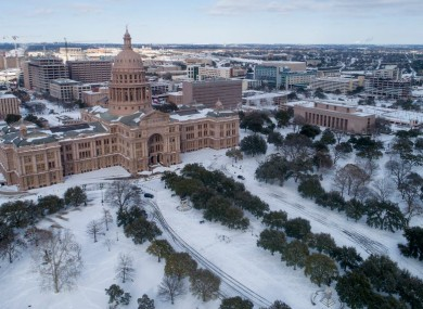 The Capitol grounds are covered in snow in Austin, Texas