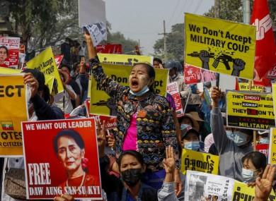 Demonstrators protest against the military junta