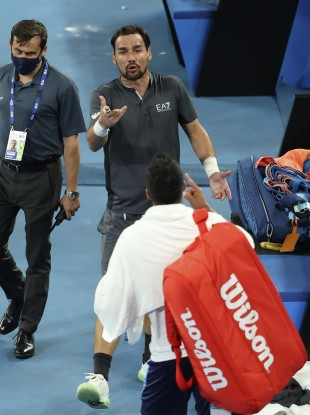 Italy's Salvatore Caruso, bottom, and compatriot Fabio Fognini argue after their second round match.
