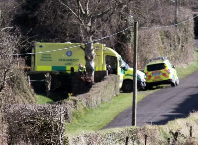 Ambulance crew at the scene near Kilacluig, close to Mitchelstown, after the body of the third brother was found.