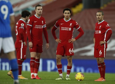 Liverpool players pictured after Brighton's Steven Alzate scores.