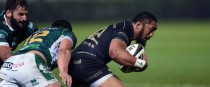 Bundee Aki is tackled by Luca Morisi.