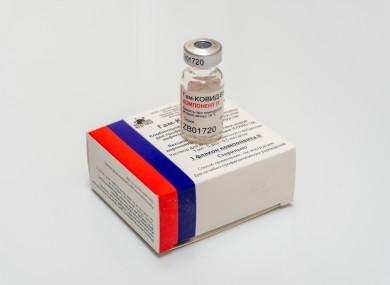 A vial containing Sputnik V vaccine .