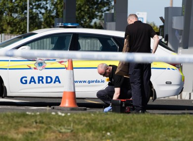 Gardaí investigating the scene after James 'Mago' Gately was shot near Dublin Airport in May 2017.