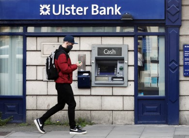 A man wearing a face mask as he passes an Ulster Bank branch in Dublin this morning.