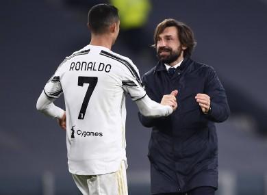 Cristiano Ronaldo and manager Andrea Pirlo celebrate.
