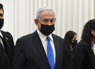 Israeli Prime Minister Benjamin Netanyahu stands at a hearing at the district court in Jerusalem.