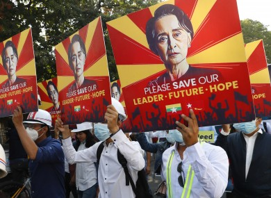 Engineers hold posters with an image of deposed Myanmar leader Aung San Suu Kyi as they hold an anti-coup protest march in Mandalay,