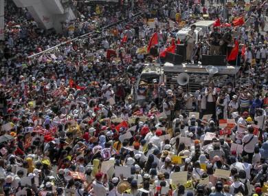 Demonstrators gather in the capital Yangon earlier today