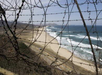 Barbed wire guards the coastal border of the separating South Korea with the demilitarized zone, looking northward towards North Korea, from the northern most point on the east coast of South Korea, near Goseong,