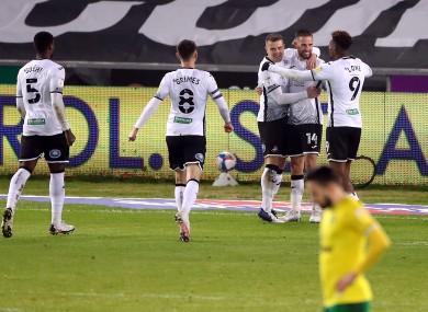 Swansea City's Conor Hourihane celebrates scoring their side's second goal.