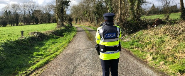 A garda at the scene in Curraghgorm where two brothers were found dead.