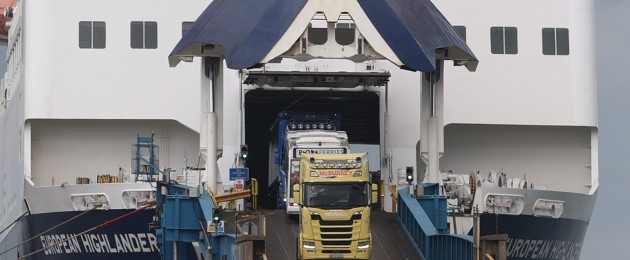Lorries driving off the European Highlander P&O ferry at the Port of Larne.