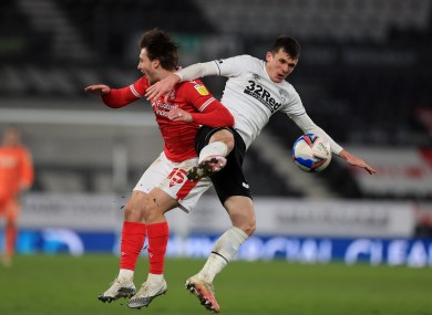 Jason Knight (right) clashing with Luke Freeman during Derby County's game against Nottingham Forest on Friday.