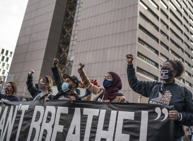 Demonstrators marched in Minneapolis on Sunday, one day before jury selection begins.