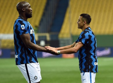 Sanchez (right) helped Inter go six points clear.