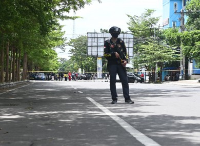A police officer stands guard near the cathedral.