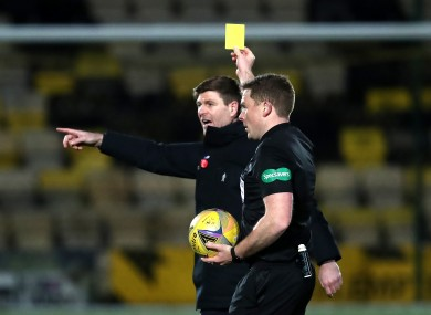 Steven Gerrard is shown a yellow card during Rangers' match at Livingston.