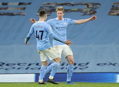 Manchester City's Kevin De Bruyne (right) celebrates with Phil Foden.
