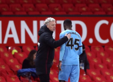 West Ham United manager David Moyes greets Ademipo Odubeko as he is substituted at Old Trafford.