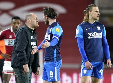 Preston North End's Alan Browne (centre) is sent off for a foul.