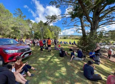 People gather on high ground in Whangarei, New Zealand
