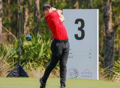 Rory McIlroy in red and black yesterday.