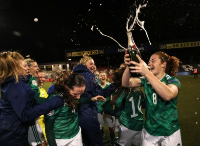 The Northern Ireland team celebrate qualifying for the Euro 2022 play-offs.
