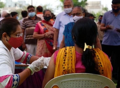 File photo a woman receiving a Covid-19 vaccine in India