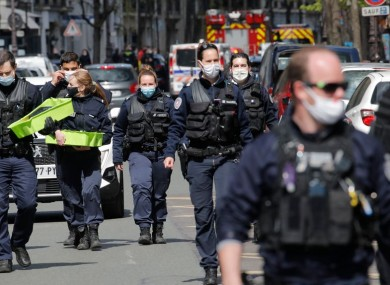 Police attend the scene of the shooting outside Henry Dupont hospital in Paris
