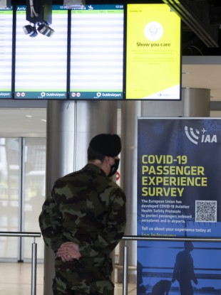 A member of the Defence Forces waits in Dublin Airport