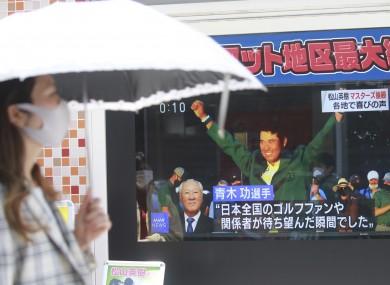 A TV screen in Tokyo shows Japanese golfer Hideki Matsuyama celebrating his Masters win.