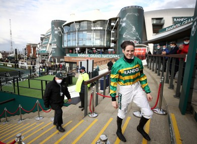 Rachael Blackmore walks back out of the winners enclosure after lifting the 2021 Grand National trophy.