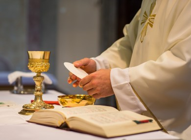 File photo of a priest preparing Communion at mass