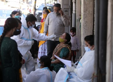 Healthcare workers swab for Covid in Jammu, India