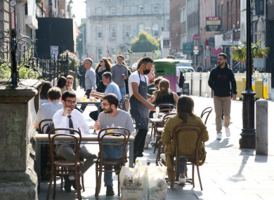 People dining outdoors in Dublin last September.